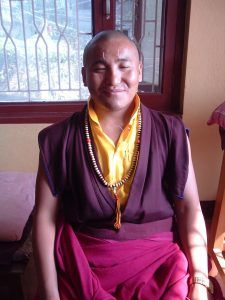 Buddhist monk with acupuncture needles